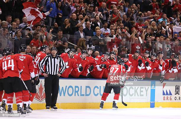 Sidney Crosby of Team Canada high fives the bench after scoring a first period goal on Team Russia at the semifinal game during the World Cup of...