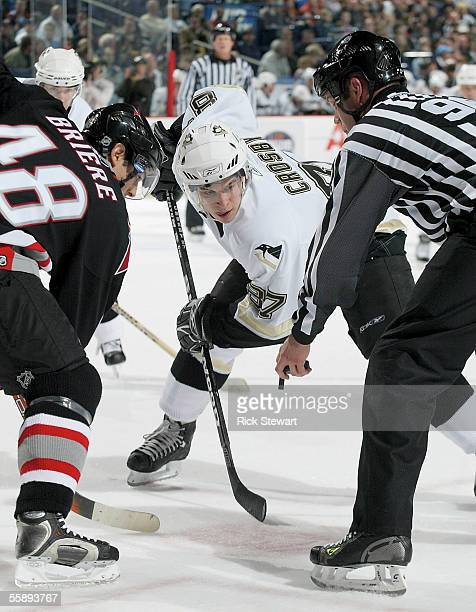 Sidney Crosby of the Piitsburgh Penguins gets ready for a face-off against Daniel Briere of the Buffalo Sabres October 10, 2005 at HSBC Arena in...