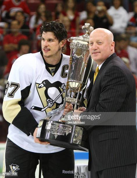 Sidney Crosby of the Pittsburgh Penguins accepts the Prince of Wales trophy from Deputy Commissioner of the NHL Bill Daly after their 41 win over the...
