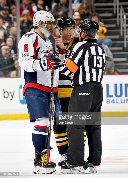 Sidney Crosby of the Pittsburgh Penguins and Alex Ovechkin of the Washington Capitals talks to referee Dan O'Halloran at PPG Paints Arena on January...