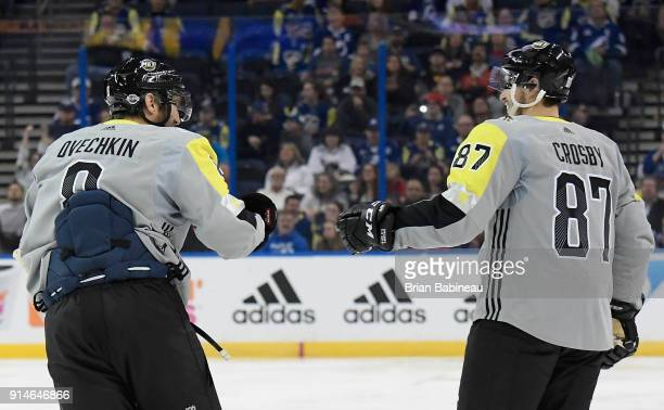 Sidney Crosby of the Pittsburgh Penguins and Alexander Ovechkin of the Washington Capitals fist bump during the 2018 Honda NHL AllStar Game between...