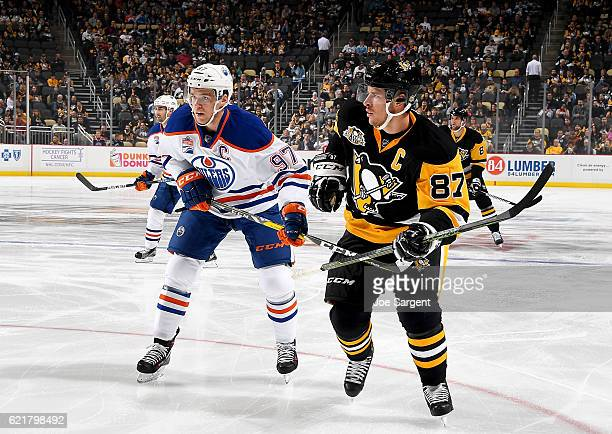 Sidney Crosby of the Pittsburgh Penguins and Connor McDavid of the Edmonton Oilers skates at PPG Paints Arena on November 8 2016 in Pittsburgh...