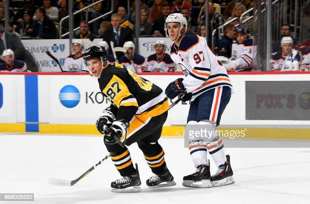 Sidney Crosby of the Pittsburgh Penguins and Connor McDavid of the Edmonton Oilers skate at PPG Paints Arena on October 24 2017 in Pittsburgh...