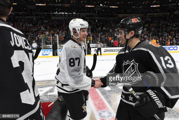 Sidney Crosby of the Pittsburgh Penguins and Johnny Gaudreau of the Calgary Flames shake hands after the 2017 Honda NHL AllStar Game at Staples...