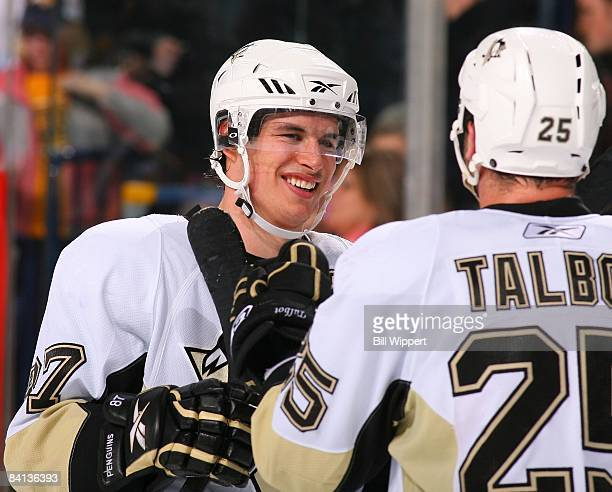 Sidney Crosby of the Pittsburgh Penguins and Maxime Talbot celebrate a victory against the Buffalo Sabres on December 22, 2008 at HSBC Arena in...