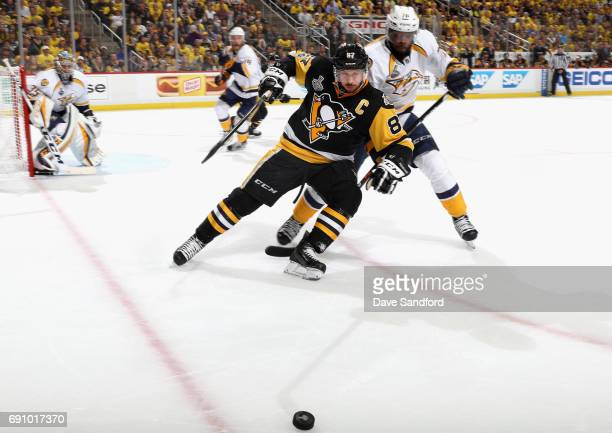 Sidney Crosby of the Pittsburgh Penguins and PK Subban of the Nashville Predators battle for the puck during the second period of Game Two of the...