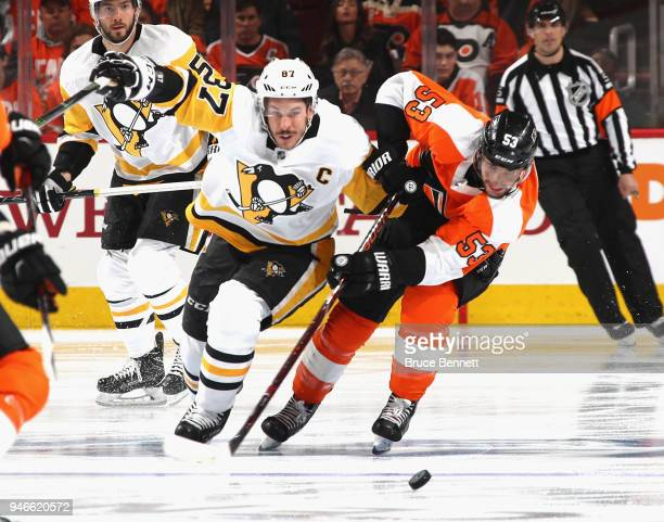 Sidney Crosby of the Pittsburgh Penguins and Shayne Gostisbehere of the Philadelphia Flyers battle for the puck during the first period in Game Three...
