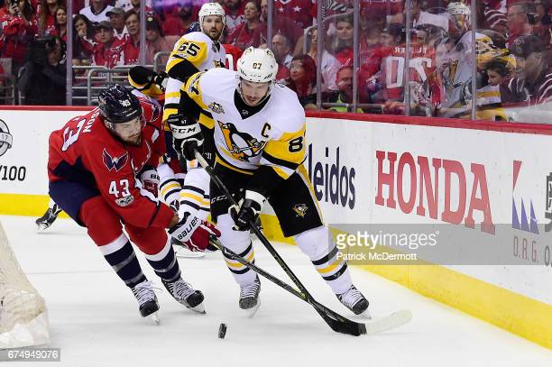 Sidney Crosby of the Pittsburgh Penguins and Tom Wilson of the Washington Capitals battle for the puck in the first period in Game Two of the Eastern...