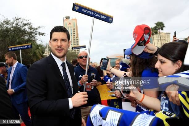 Sidney Crosby of the Pittsburgh Penguins arrives on the red carpet prior to the 2018 Honda NHL AllStar Game at Amalie Arena on January 28 2018 in...