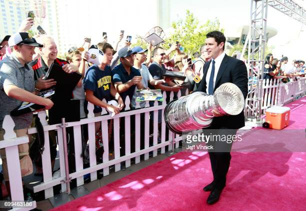 Sidney Crosby of the Pittsburgh Penguins arrives with the Stanley Cup on the magenta carpet for the 2017 NHL Awards at T-Mobile Arena on June 21,...