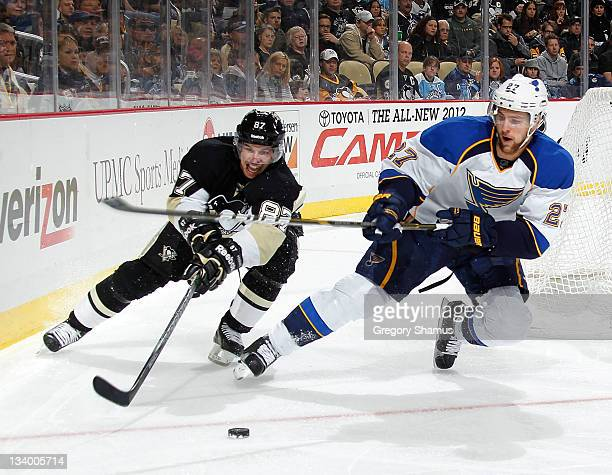 Sidney Crosby of the Pittsburgh Penguins battles for the puck against Alex Pietrangelo of the St Louis Blues on November 23 2011 at Consol Energy...
