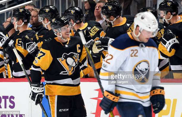 Sidney Crosby of the Pittsburgh Penguins celebrate his second period goal against the Buffalo Sabres at PPG Paints Arena on November 14 2017 in...
