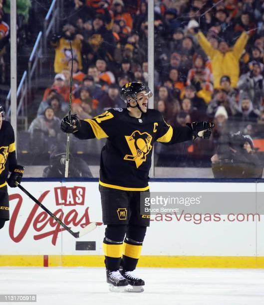 Sidney Crosby of the Pittsburgh Penguins celebrates a second period goal by Justin Schultz against the Philadelphia Flyers during the 2019 Coors...
