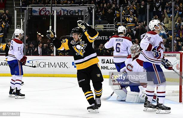 Sidney Crosby of the Pittsburgh Penguins celebrates an overtime goal scored by Evgeni Malkin against the Montreal Canadiens at PPG PAINTS Arena on...