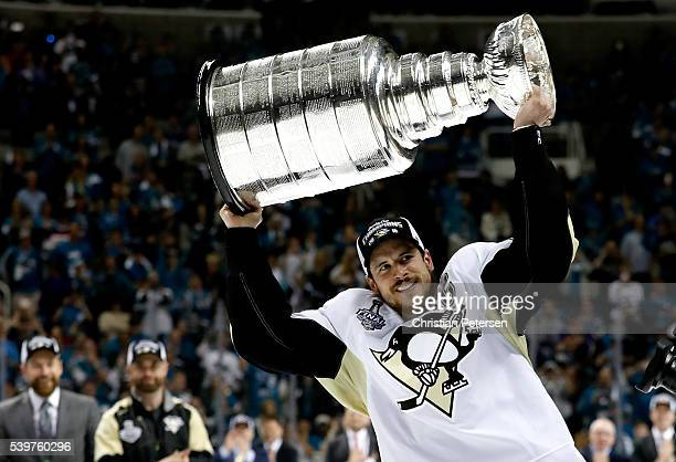 Sidney Crosby of the Pittsburgh Penguins celebrates by hoisting the Stanley Cup after their 31 victory to win the Stanley Cup against the San Jose...