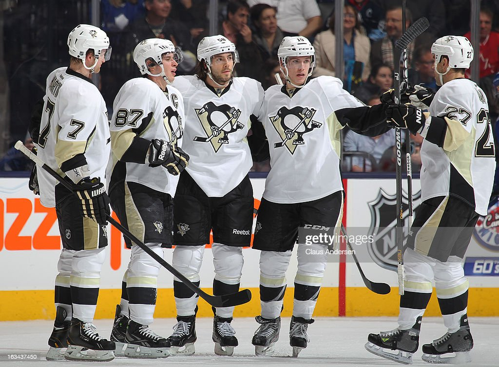 Sidney Crosby #87 of the Pittsburgh Penguins celebrates his 12th goal of the season with his teammates in a game against the Toronto Maple Leafs on March 9, 2013 at the Air Canada Centre in Toronto, Ontario, Canada.