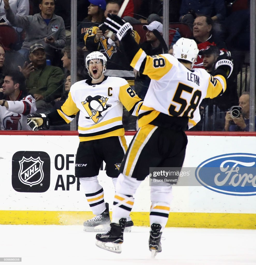Sidney Crosby #87 of the Pittsburgh Penguins celebrates his game winning goal in overtime against the New Jersey Devils at the Prudential Center on March 29, 2018 in Newark, New Jersey. The Penguins defeated the Devils 4-3 in overtime.