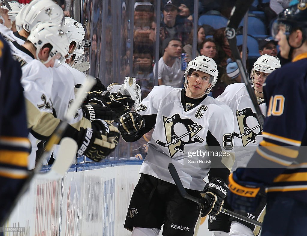 Sidney Crosby #87 of the Pittsburgh Penguins celebrates his goal against the Buffalo Sabres with teammates along the bench at First Niagara Center on February 5, 2014 in Buffalo, New York. Pittsburgh defeated Buffalo 5-1. (Photo by Sean Rudyk/Getty Images).