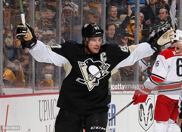 Sidney Crosby of the Pittsburgh Penguins celebrates his goal during the second period against the Carolina Hurricanes at Consol Energy Center on...