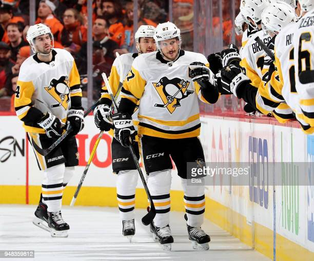 Sidney Crosby of the Pittsburgh Penguins celebrates his goal with teammates on the bench in the second period against the Philadelphia Flyers in Game...