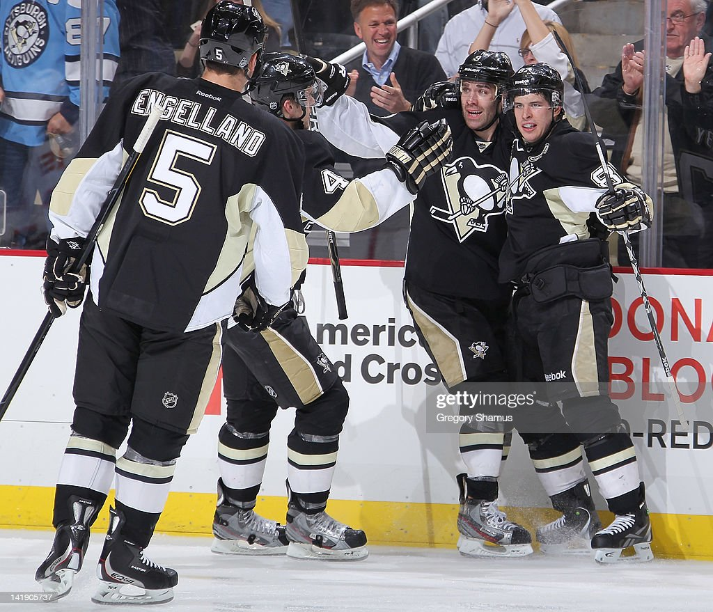 Sidney Crosby #87 of the Pittsburgh Penguins celebrates his goal with teammates during the third period against the New Jersey Devils on March 25, 2012 at Consol Energy Center in Pittsburgh, Pennsylvania.