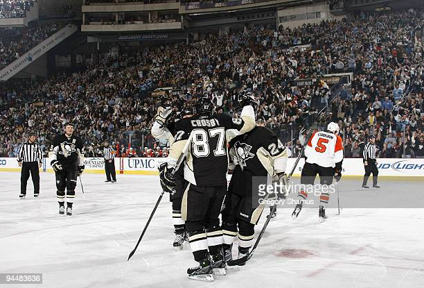 Sidney Crosby of the Pittsburgh Penguins celebrates his goal with teammates against the Philadelphia Flyers on December 15 2009 at Mellon Arena in...