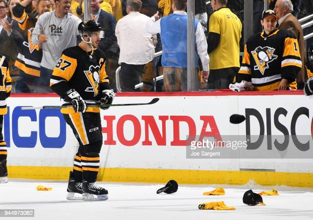 Sidney Crosby of the Pittsburgh Penguins celebrates his hattrick goal during the third period against the Philadelphia Flyers in Game One of the...