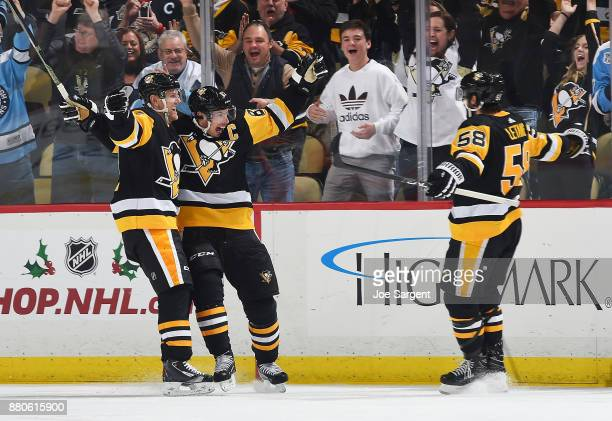 Sidney Crosby of the Pittsburgh Penguins celebrates his overtime goal with Patric Hornqvist and Kris Letang during the game against the Philadelphia...