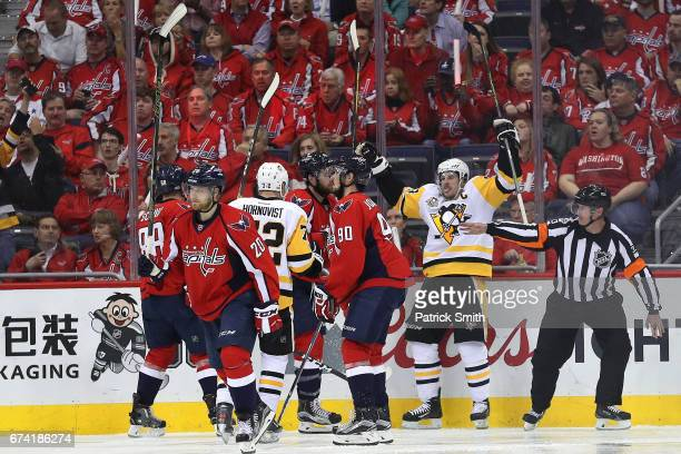 Sidney Crosby of the Pittsburgh Penguins celebrates his second goal of the second period with teammates against the Washington Capitals in Game One...