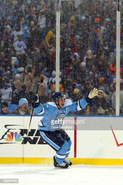Sidney Crosby of the Pittsburgh Penguins celebrates his shoot out goal to win the NHL Winter Classic 21 over the Buffalo Sabres at the Ralph Wilson...