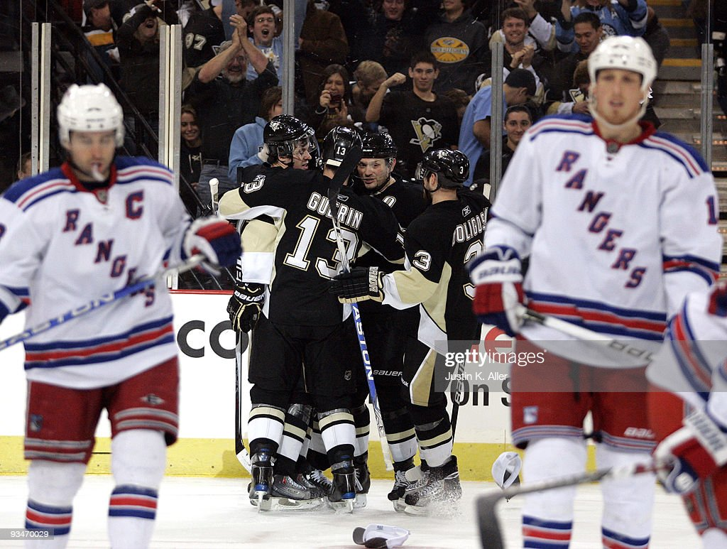 Sidney Crosby #87 of the Pittsburgh Penguins celebrates his third goal of the game against the New York Rangers with teammates in the third period at Mellon Arena on November 28, 2009 in Pittsburgh, Pennsylvania. Penguins won 8-3.