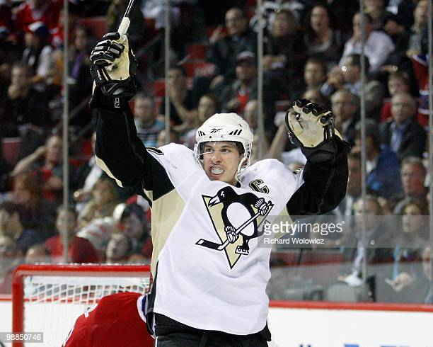 Sidney Crosby of the Pittsburgh Penguins celebrates the third period goal by Evgeni Malkin in Game Three of the Eastern Conference Semifinals during...