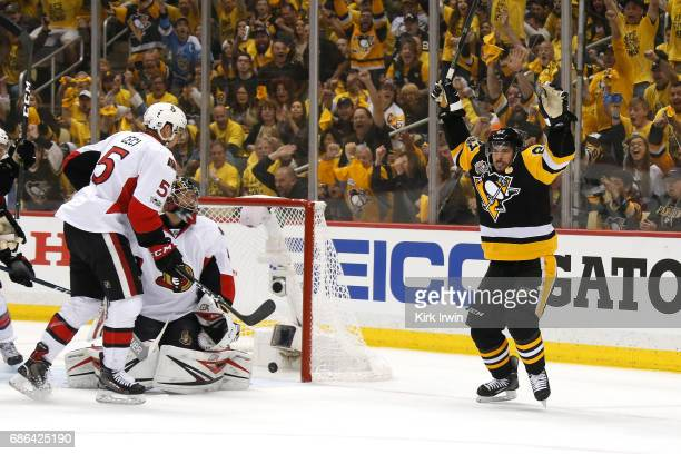 Sidney Crosby of the Pittsburgh Penguins celebrates with his teammates after scoring a goal against Craig Anderson of the Ottawa Senators during the...