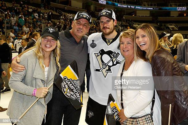 Sidney Crosby of the Pittsburgh Penguins celebrates with his family after their 31 victory to win the Stanley Cup against the San Jose Sharks in Game...