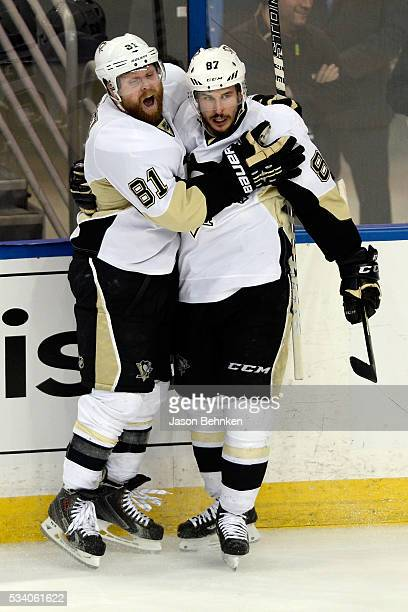 Sidney Crosby of the Pittsburgh Penguins celebrates with his teammate Phil Kessel after scoring a goal against Andrei Vasilevskiy of the Tampa Bay...