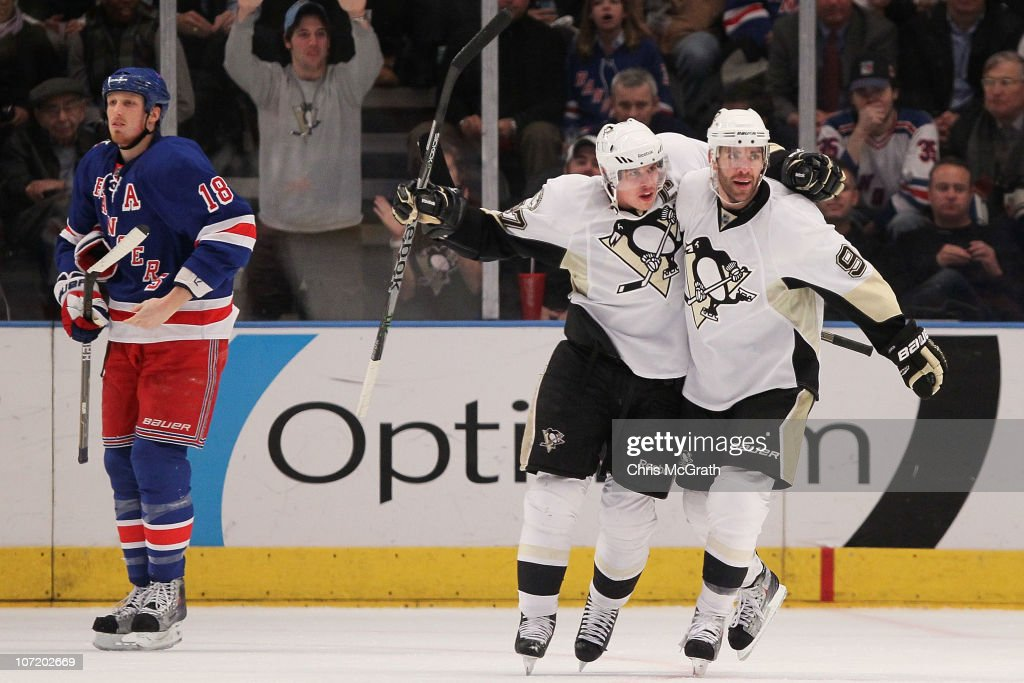 Sidney Crosby #87 of the Pittsburgh Penguins celebrates with Pacal Dupuis #9 after team mate Kris Letang #58 scored a goal against the New York Rangers during their game on November 29, 2010 at Madison Square Garden in New York City.