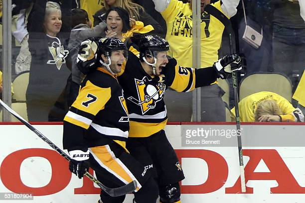 Sidney Crosby of the Pittsburgh Penguins celebrates with teammate Matt Cullen after scoring a goal in overtime against Andrei Vasilevskiy of the...