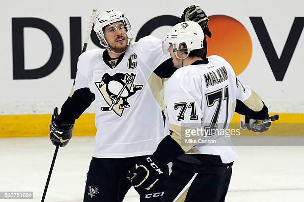 Sidney Crosby of the Pittsburgh Penguins celebrates with teammate Evgeni Malkin after scoring a goal against Andrei Vasilevskiy of the Tampa Bay...