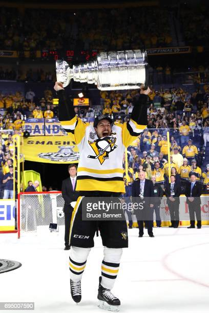 Sidney Crosby of the Pittsburgh Penguins celebrates with the Stanley Cup Trophy after they defeated the Nashville Predators 2-0 to win the 2017 NHL...