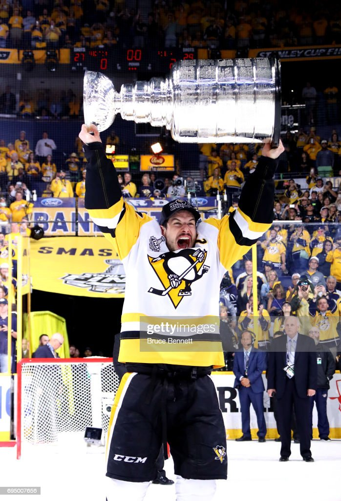 Sidney Crosby #87 of the Pittsburgh Penguins celebrates with the Stanley Cup Trophy after they defeated the Nashville Predators 2-0 to win the 2017 NHL Stanley Cup Final at the Bridgestone Arena on June 11, 2017 in Nashville, Tennessee.