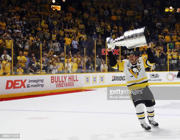 Sidney Crosby of the Pittsburgh Penguins celebrates with the Stanley Cup following a victory over the Nashville Predators in Game Six of the 2017 NHL...