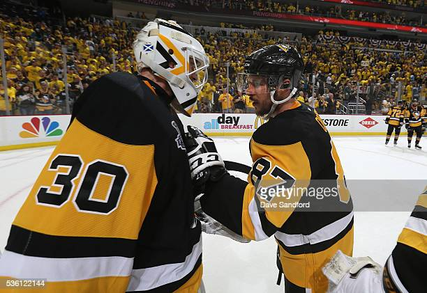 Sidney Crosby of the Pittsburgh Penguins congratulates teammate goaltender Matt Murray after Game One of the 2016 NHL Stanley Cup Final against the...