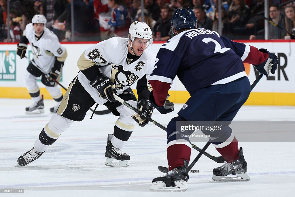 Sidney Crosby #87 of the Pittsburgh Penguins controls the puck against Nick Holden #2 of the Colorado Avalanche at Pepsi Center on December 9, 2015 in Denver, Colorado.