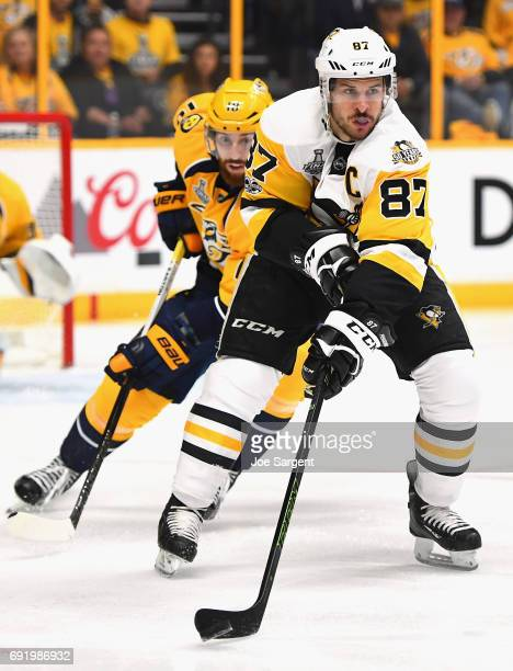 Sidney Crosby of the Pittsburgh Penguins controls the puck away from James Neal of the Nashville Predators during the first period of Game Three of...