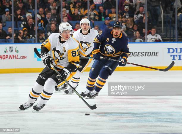Sidney Crosby of the Pittsburgh Penguins controls the puck during the second period of an NHL game against the Buffalo Sabres on December 1 2017 at...