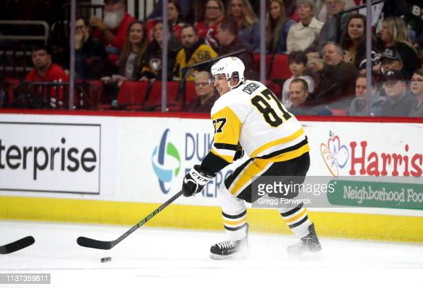 Sidney Crosby of the Pittsburgh Penguins controls the puck on the icce during an NHL game against the Carolina Hurricanes on March 19 2019 at PNC...