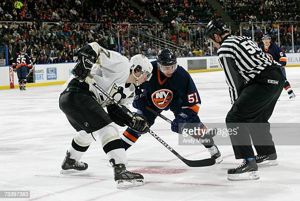 Sidney Crosby of the Pittsburgh Penguins faces off against Frans Nielsen of the New York Islanders at Nassau Coliseum on February 19 2007 in...