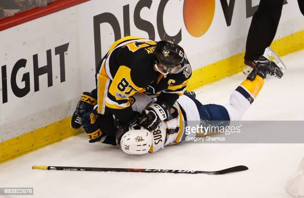 Sidney Crosby of the Pittsburgh Penguins falls on top of PK Subban of the Nashville Predators during the first period in Game Five of the 2017 NHL...