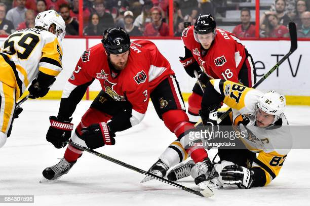 Sidney Crosby of the Pittsburgh Penguins falls to the ice against Marc Methot of the Ottawa Senators during the second period in Game Three of the...