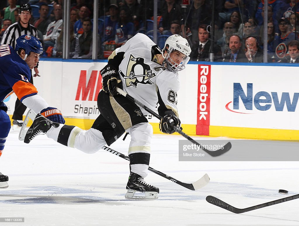 Sidney Crosby #87 of the Pittsburgh Penguins fires the puck down the ice during the game against the New York Islanders in Game Three of the Eastern Conference Quarterfinals during the 2013 NHL Stanley Cup Playoffs at Nassau Veterans Memorial Coliseum on May 5, 2013 in Uniondale, New York. The Penguins defeated the Islanders 5-4 in overtime.